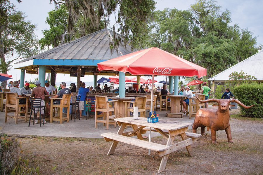 The bar at Old Daufuskie Crab Co., is a beachy, no-frills spot to watch the sunset.